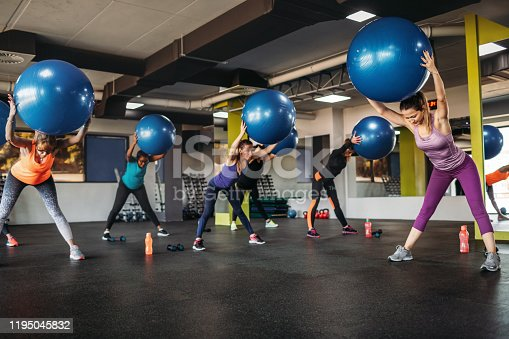 1195045259istockphoto Athletic Women Exercising In The Gym 1195045832