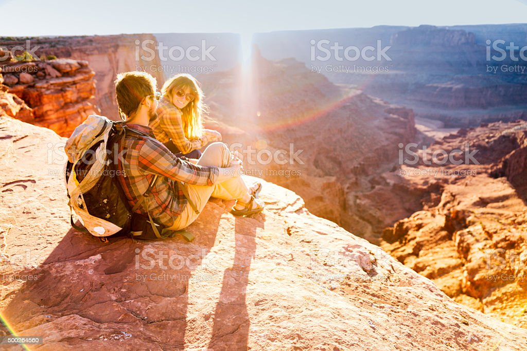 Athletic Young Couple Admiring a Beautiful View in the Southwest stock photo