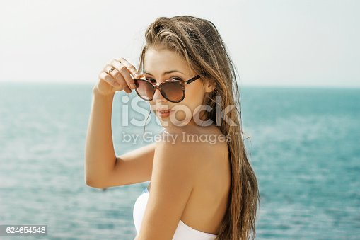 istock athletic young girl on the beach 624654548