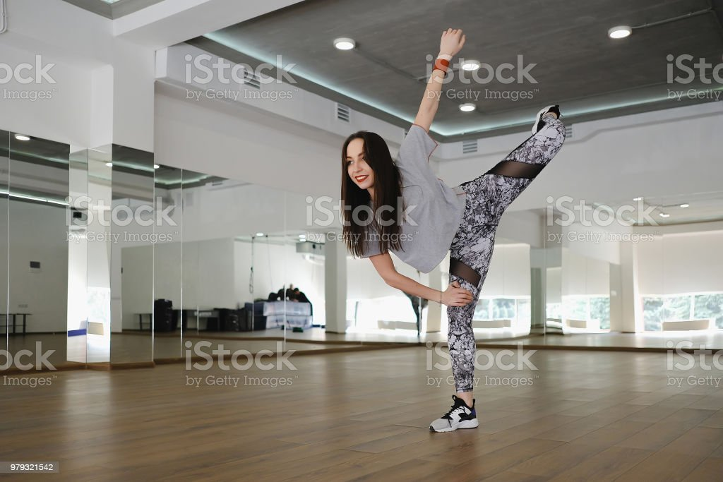 Athletic young girl performing alone in a studio. Girl dancer...
