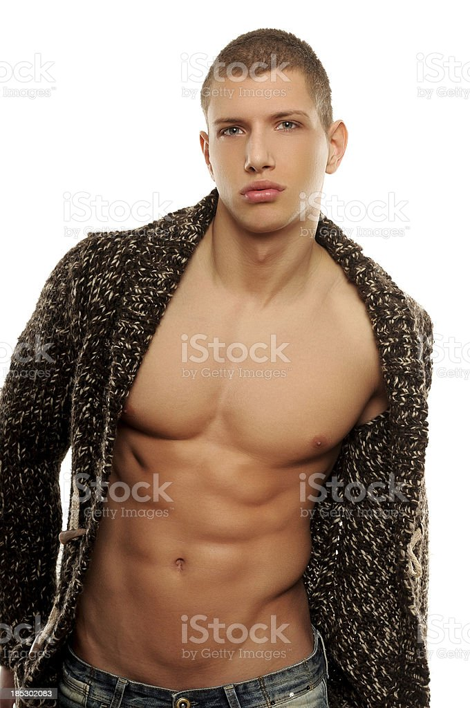 Athletic young man in the unbuttoned sweater stock photo