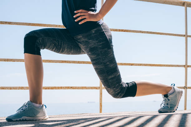 athletic young woman doing lunges - lunge stock photos and pictures