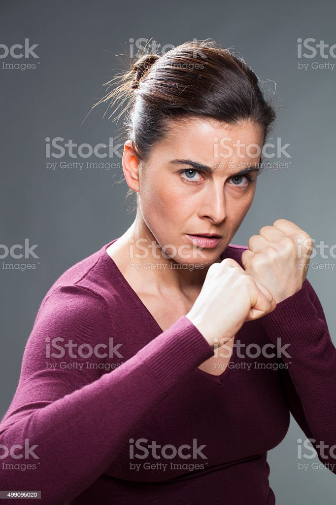 athletic young woman provoking a fight with her body language stock photo