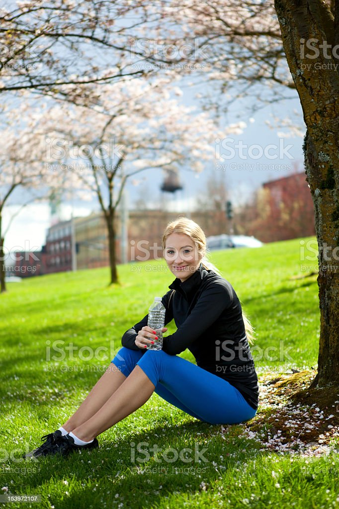 Athletic young woman smiling royalty-free stock photo