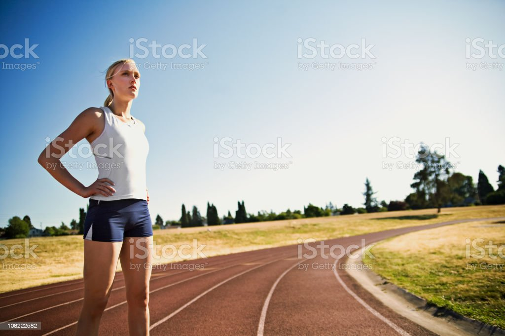 Athletic Young Woman Standing on Running Track - Royalty-free Adult Stock Photo