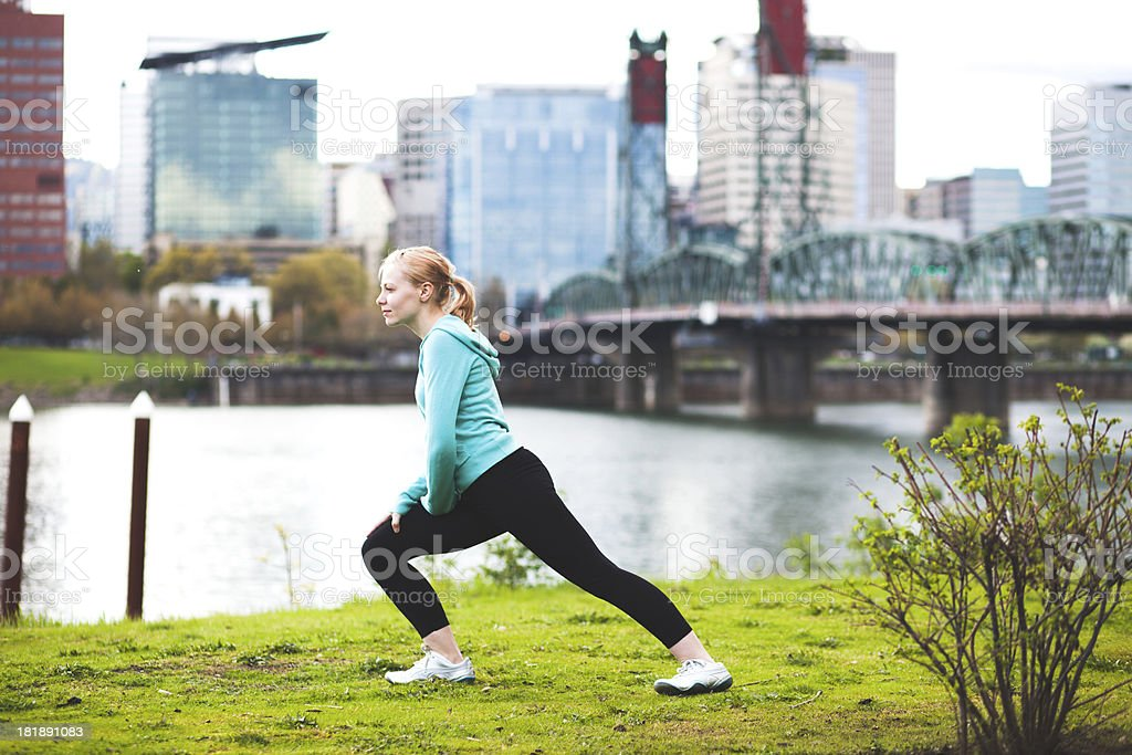 Athletic Young Woman Stretching Before Run royalty-free stock photo