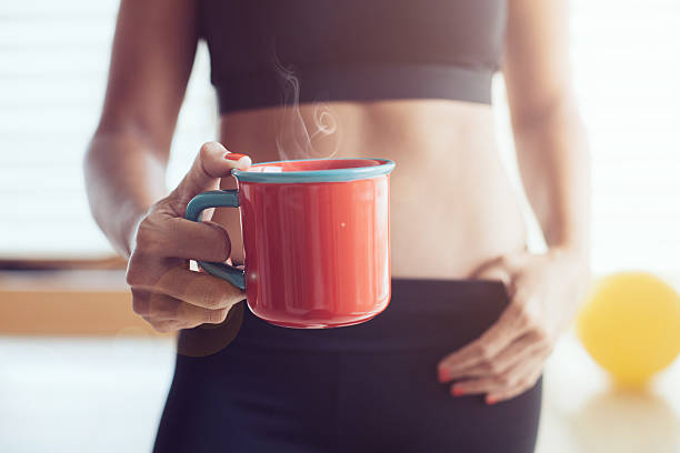Athletic young woman with cup - foto de stock