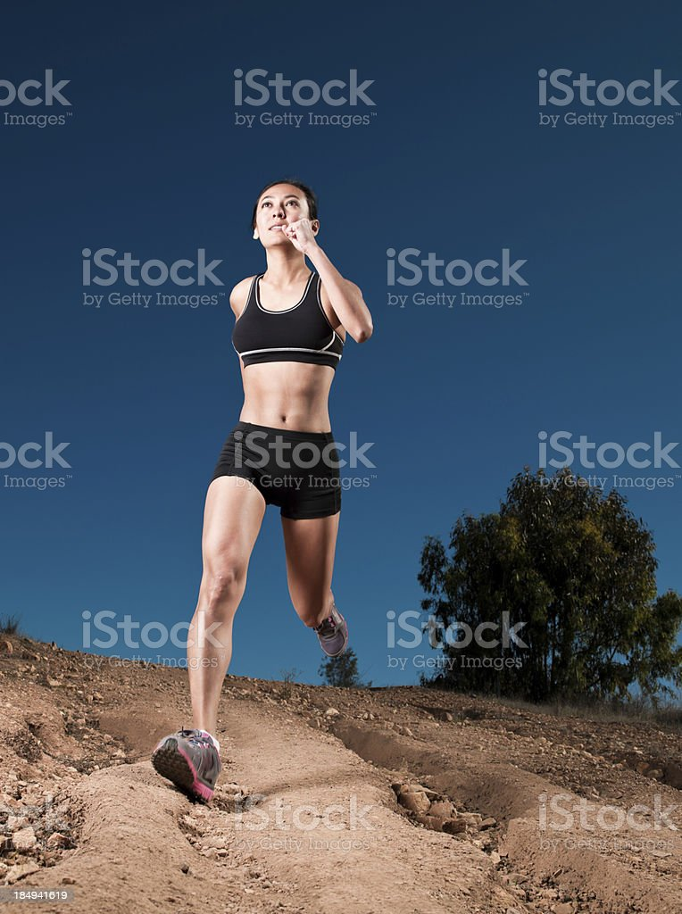 Athletic Young Women Running On a Dirt Road royalty-free stock photo