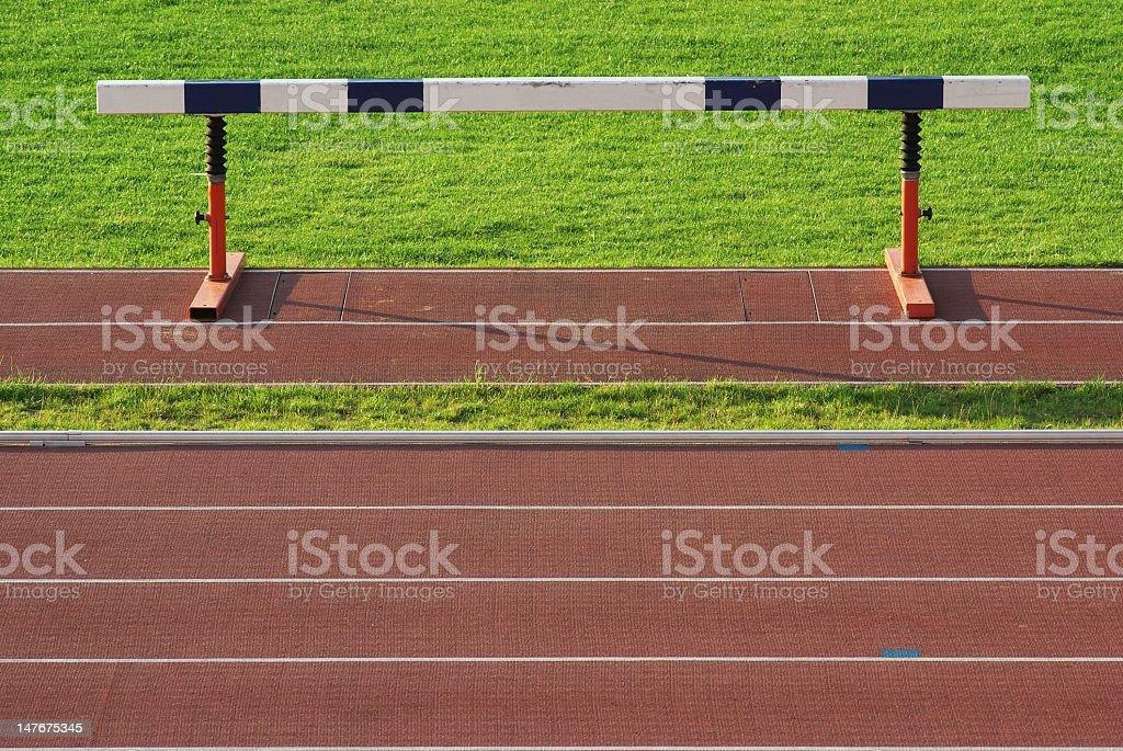 athletics hurdle on stadium and red running tracks royalty-free stock photo