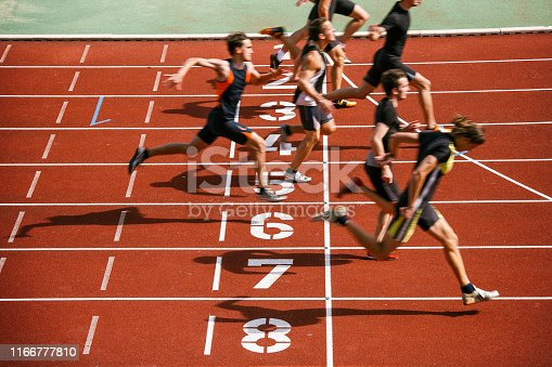 Sprint competition on running track. Finish line low angle view.