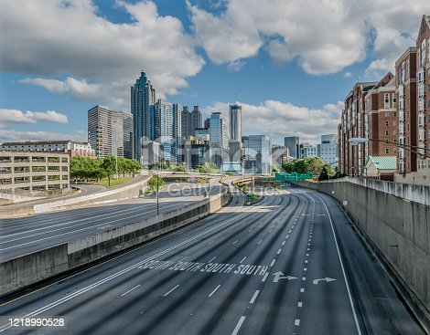 Coronavirus pandemic affects rush hour traffic on Atlanta, GA interstate seen from North Avenue Bridge