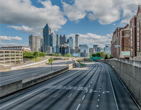 Coronavirus pandemic affects rush hour traffic on Atlanta, GA interstate seen from North Avenue Bridge