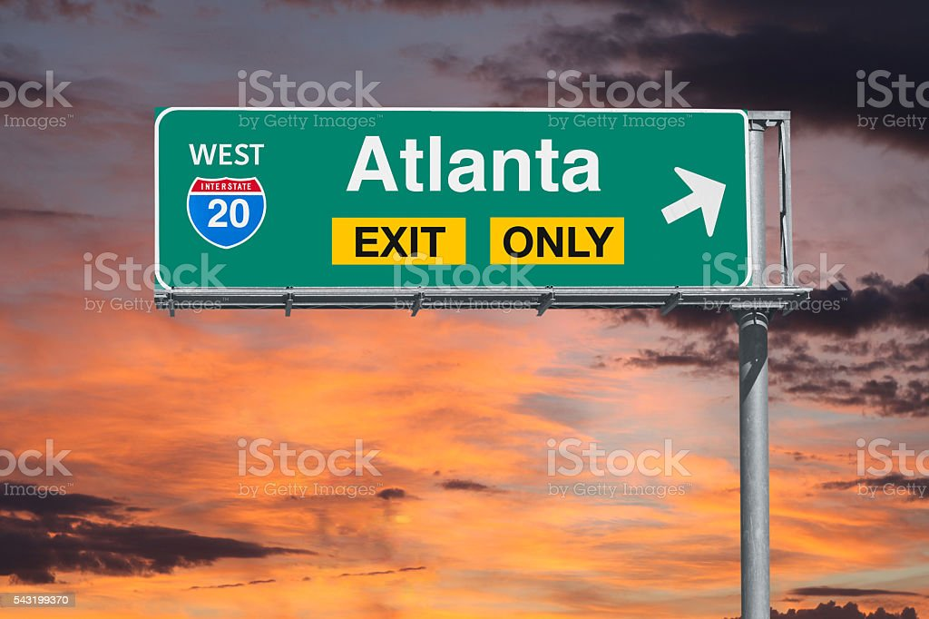 Atlanta Exit Only Freeway Sign with Sunrise Sky – Foto