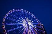 Atlanta's new 200 foot tall ferris wheel skyview illuminates the sky.