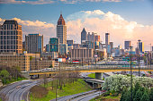 Atlanta, Georgia, USA downtown city skyline over highways at dusk.