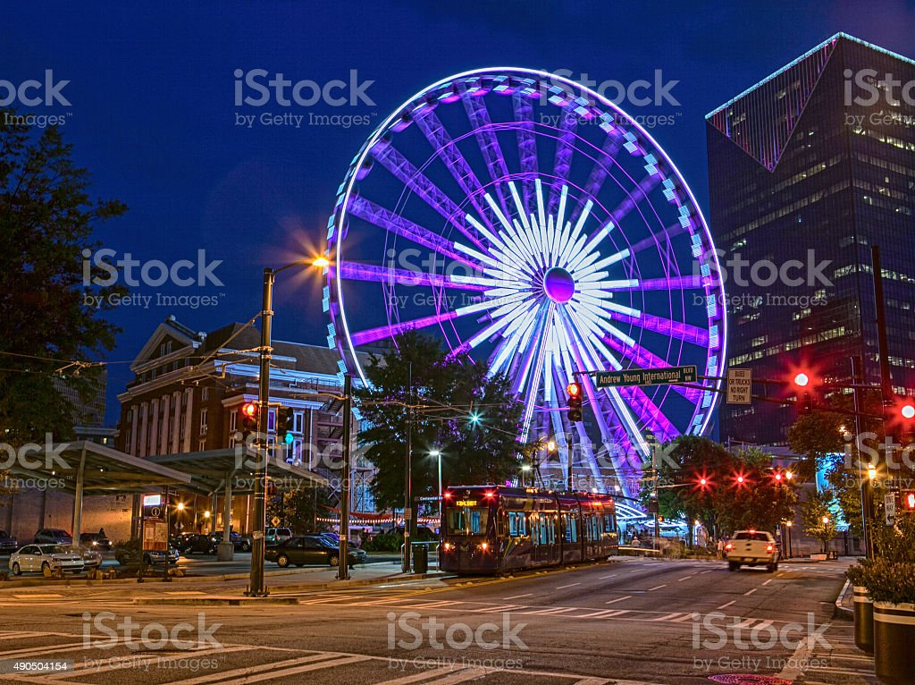 atlanta street trolley and ferris wheel stock photo