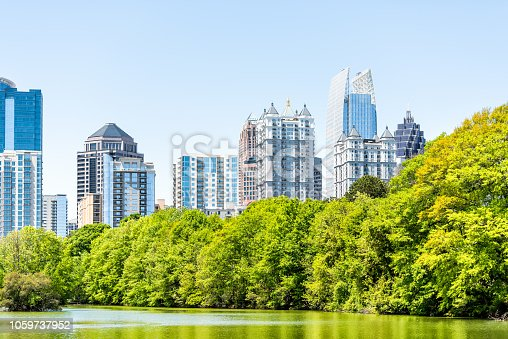 Atlanta, USA Cityscape, skyline view in Piedmont Park in Georgia downtown, green trees, scenic urban city skyscrapers