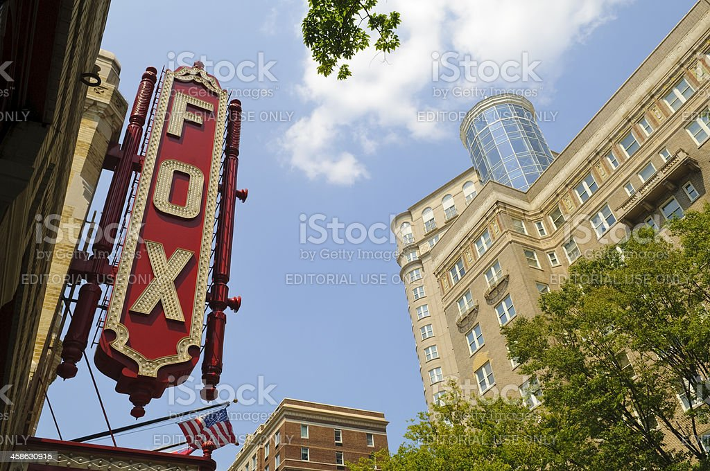 Atlanta's Fox Theater Atlanta, GA, USA - August 3, 2011:The colorful neon sign on the front marquee of the historic Fox Theater at 660 Peachtree Street NE in Midtown Atlanta. In 1929 it opened as a 5,000-seat movie theater; today it is a performing arts venue that hosts a variety of events, including the Atlanta Ballet, a summer film series, and performances by national touring companies of Broadway shows. American Culture Stock Photo