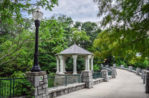 Wide Pedestrian Walkway (Concrete Bridge) above Pond and Beautiful Gazebo / Pavilion in Piedmont Park - Atlanta, Georgia, USA