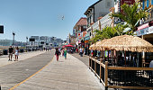 Atlantic City, NJ boardwalk with shops and people taken on Aug 14 2015