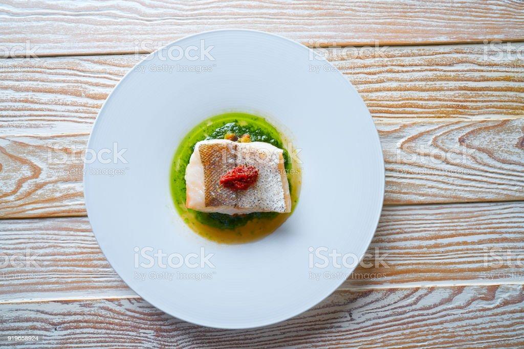 Atlantic hake over dried tomato ratatouille stock photo