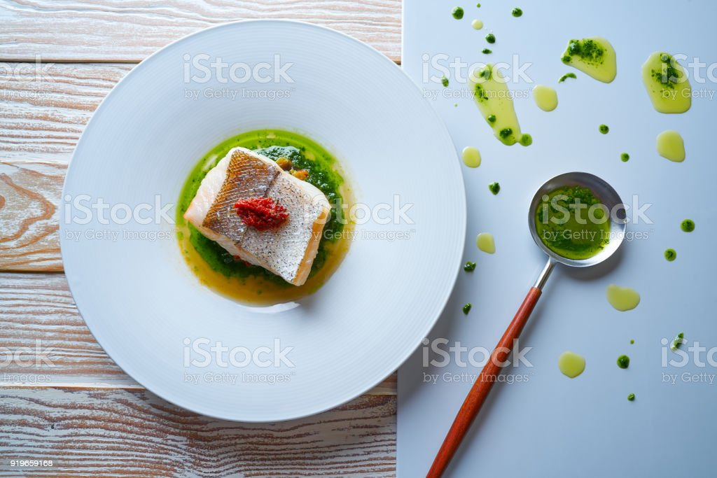 Atlantic hake over dried tomato ratatouille stock photo