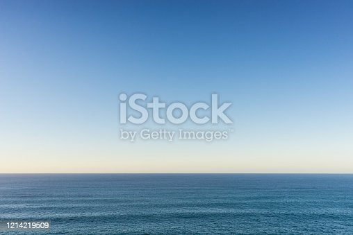 A calm Atlantic ocean and clear evening sky.