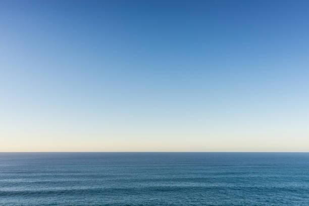 Atlantic ocean and clear sky A calm Atlantic ocean and clear evening sky. atlantic ocean stock pictures, royalty-free photos & images