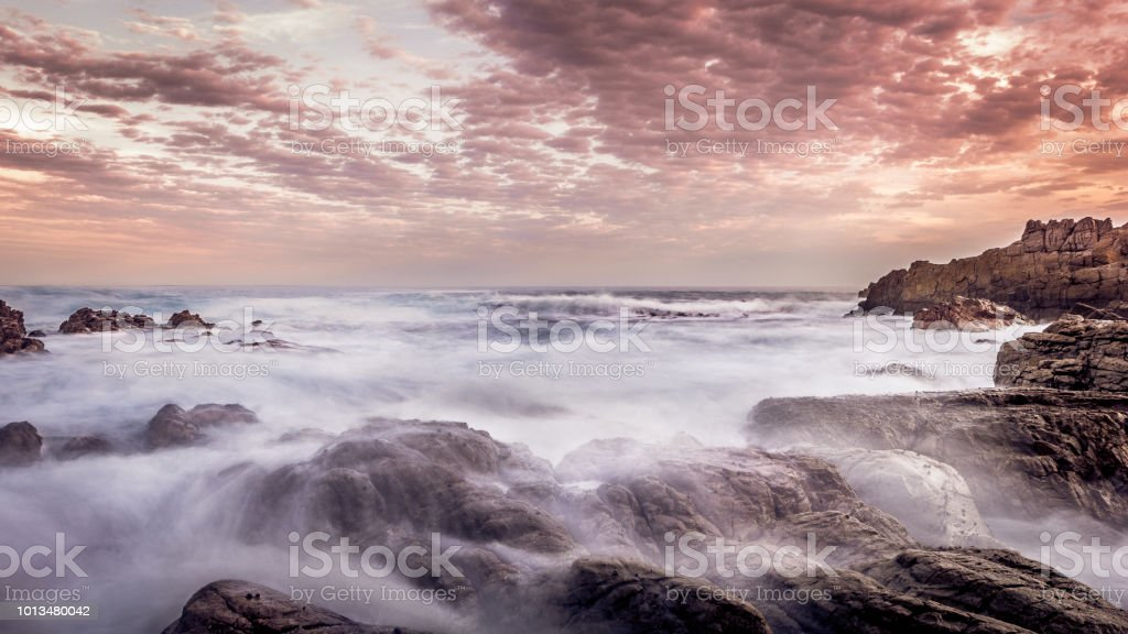 Atlantic Ocean at sunset Sunset in South Africa. Adventure Stock Photo