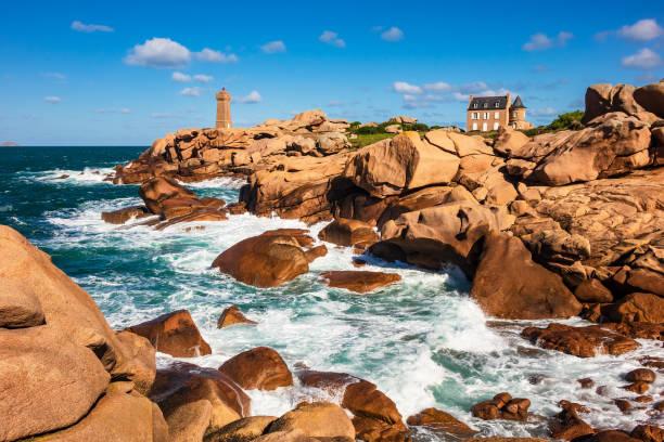 Atlantic ocean coast in Brittany near Ploumanach, France Atlantic ocean coast in Brittany near Ploumanach, France. coastal feature stock pictures, royalty-free photos & images