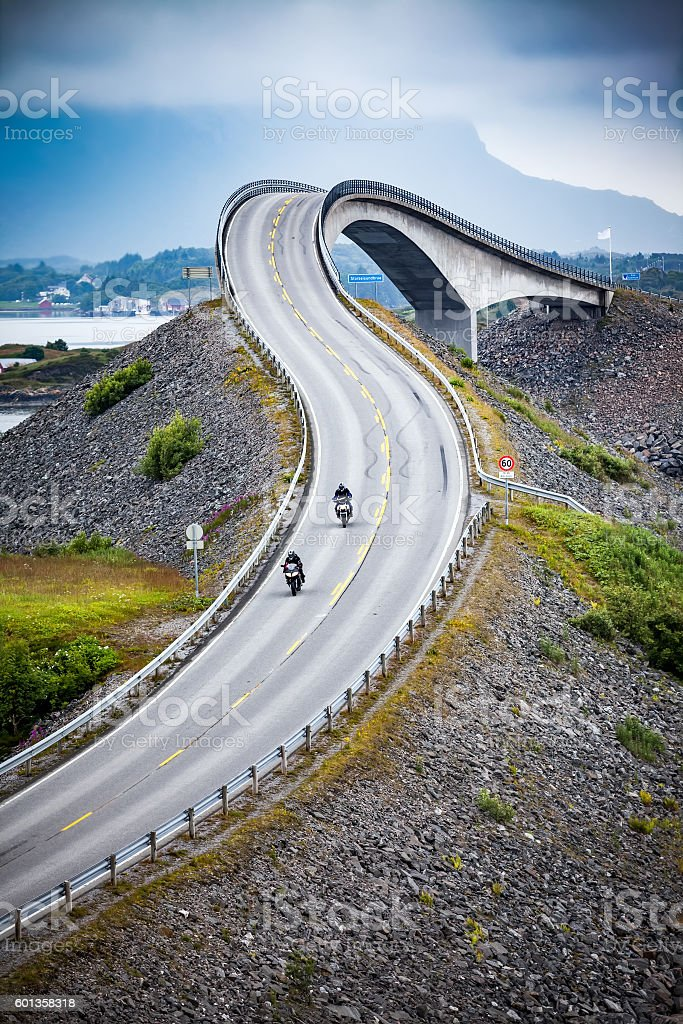 Atlantic Ocean Road Two bikers on motorcycles. stock photo