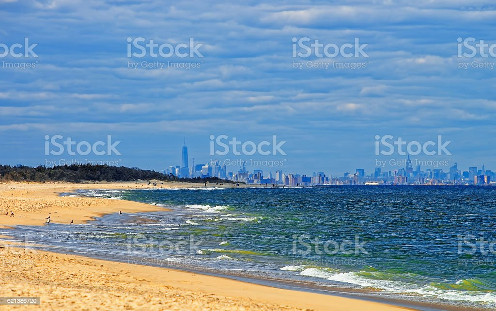 Atlantic Ocean shore at Sandy Hook with view to NYC stock photo