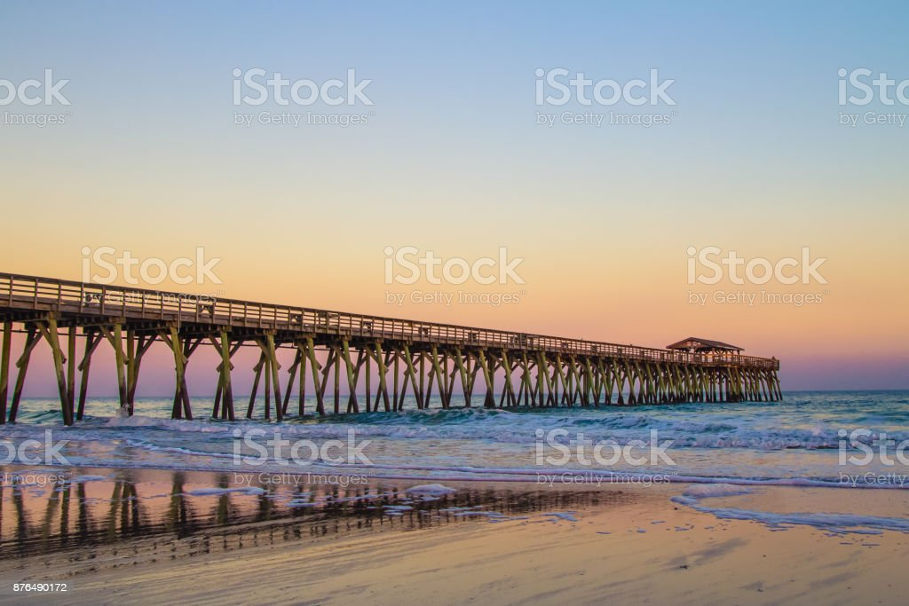Atlantic Ocean Sunset And Long Wooden Pier Along The Grand Strand Coast In Myrtle Beach South Carolina stock photo
