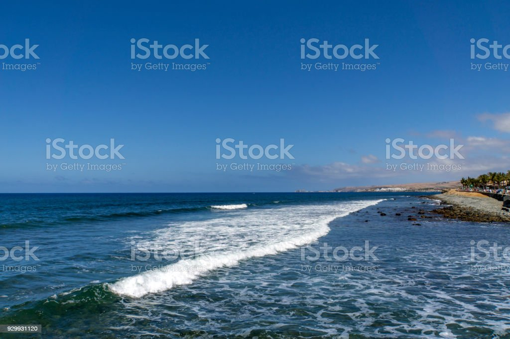 Atlantic Ocean Waves approaching Maspalomas Waterside / Spain