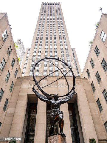 New York City, USA - April 28, 2019:  View of the Atlas holding the world on his shoulders - a bronze statue in front of Rockefeller Center in midtown Manhattan.