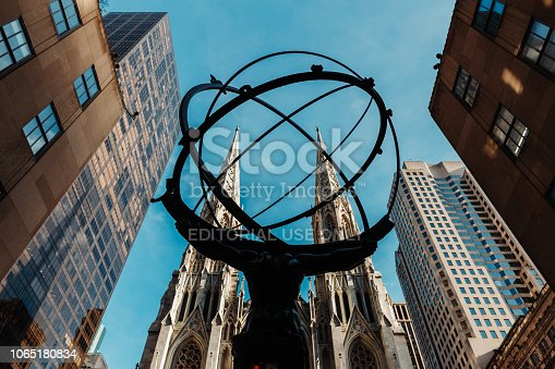 New York City, NY, USA - November 7, 2018: View of the Atlas holding the world on his shoulders, facing newly cleaned Saint Patrick's Cathedral.