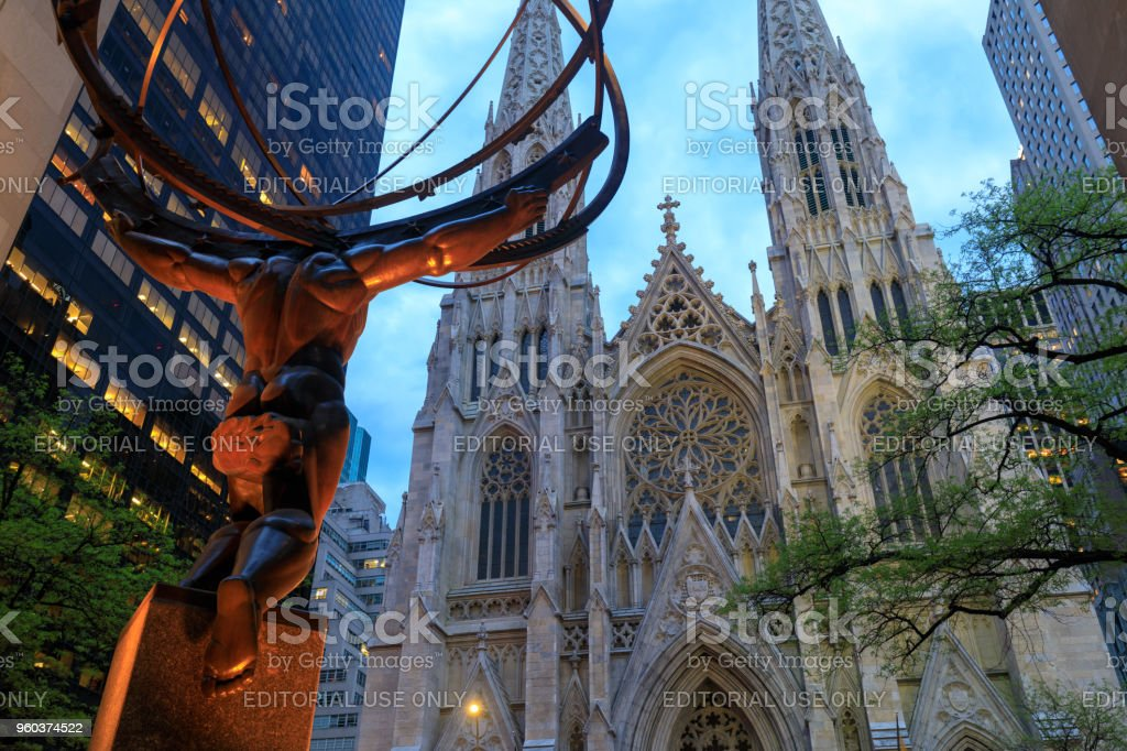 Atlas statue and St. Patrick's Cathedral at night located in Fifth Avenue, Manhattan, NYC stock photo
