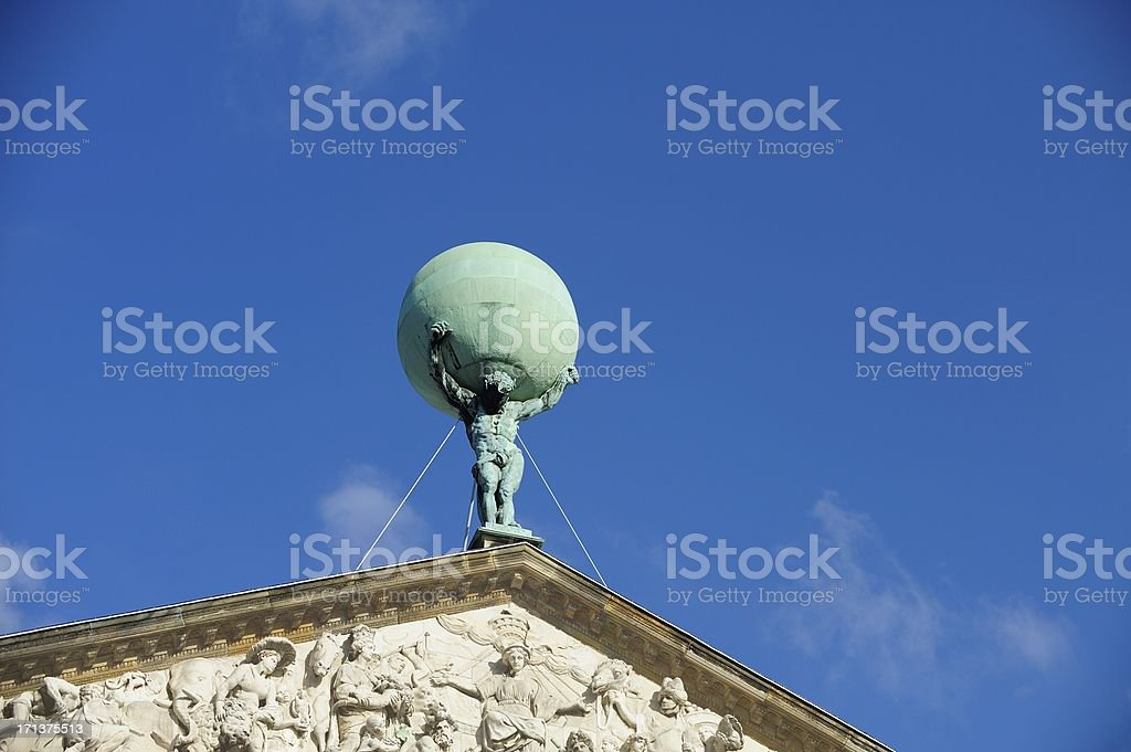 Atlas statue on the Royal Palace in Amsterdam royalty-free stock photo