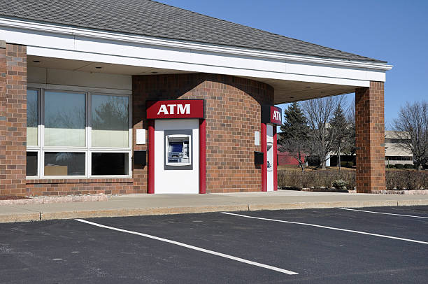 atm machine outdoor atm or automated teller machine banks and atms stock pictures, royalty-free photos & images