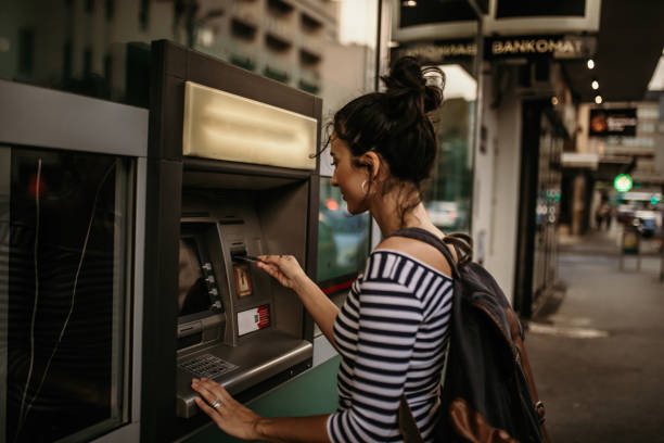 Atm Woman using ATM machine banks and atms stock pictures, royalty-free photos & images