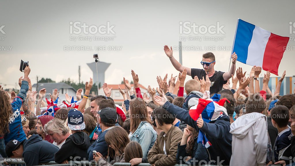 atmosphere of football fan in a fanzone stock photo