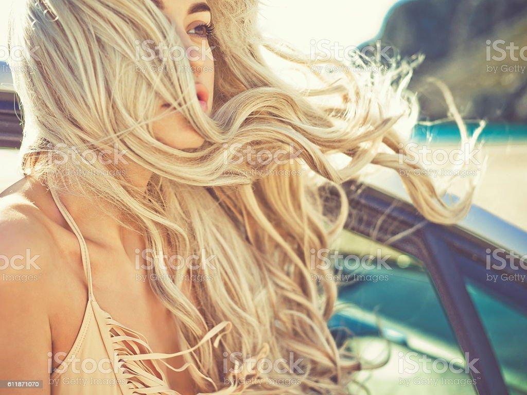 Atmospheric portrait of beautiful blonde in car stock photo