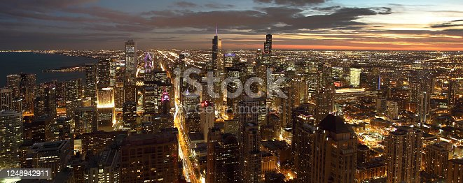483312814 istock photo Atmospheric scene of Chicago at night showing Michigan Avenue and downtown 1248942911