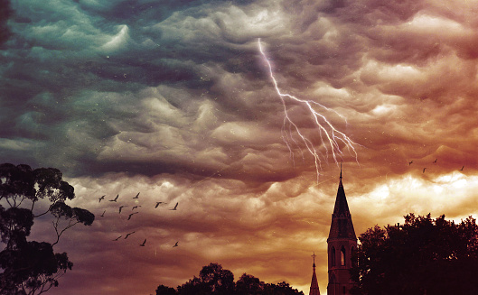 Atmospheric stormy sky over church