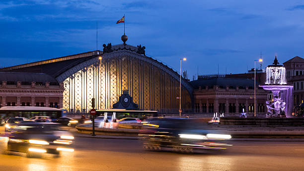 Atocha station of Madrid, Spain, at night - foto de stock
