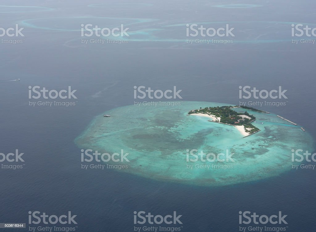 Atoll in Maldives from aerial view stock photo