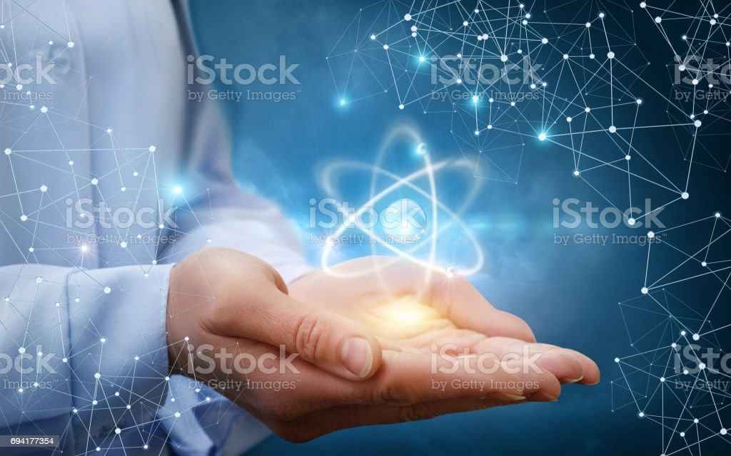 Atom molecule in female hands. stock photo