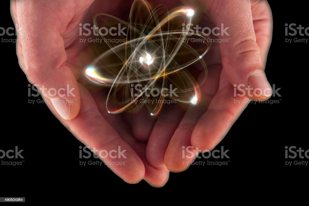Atom Particle Hands stock photo