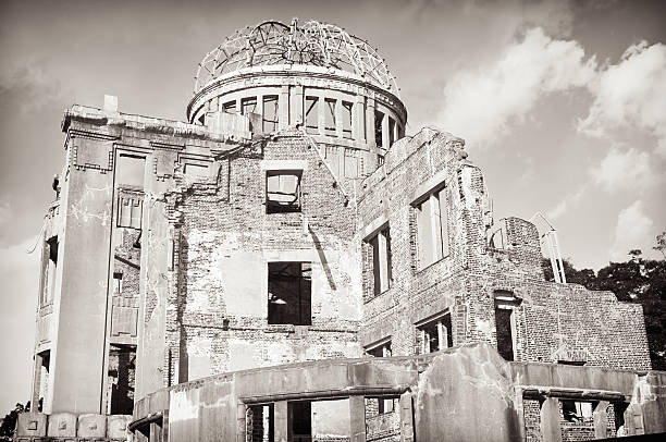 Atomic Bomb Dome Building, Hiroshima Black and white image of the Atomic Bomb Dome building in Hiroshima, Japan.  The building was very close to the detonation position of the nuclear bomb which fell on the city on 6th August, 1945.  It has been intentionally left in an unrepaired state since then. hiroshima prefecture stock pictures, royalty-free photos & images