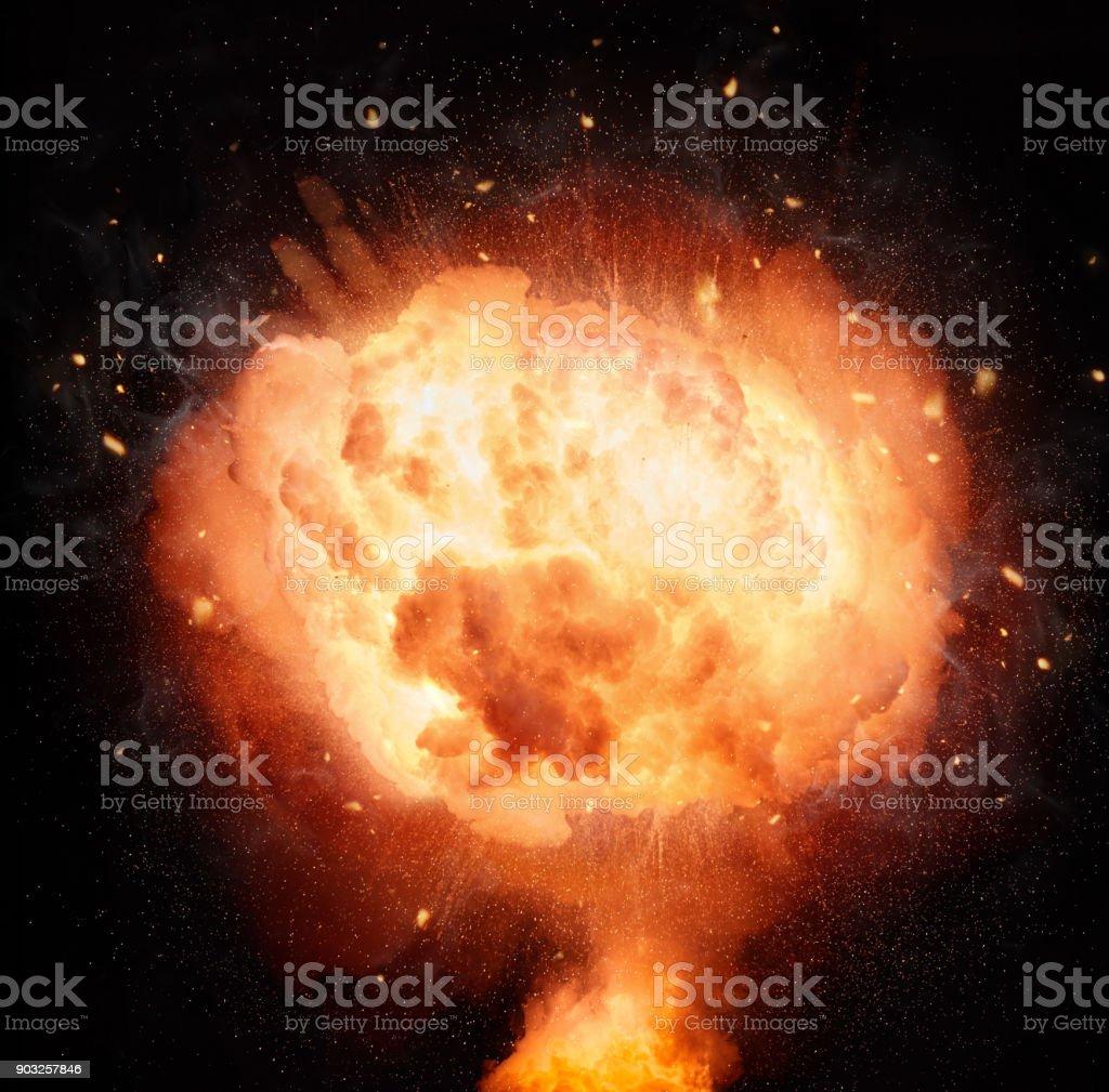 Atomic bomb explosion isolated on black background stock photo